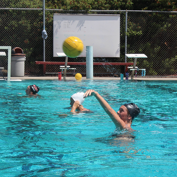 The women's water polo team practices passing the ball at the pool on Sept. 5. Justin Gonzalez/The Telescope