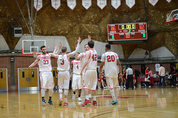 The Palomar College Comets celebrate with high-fives after defeating San Deigo City College 86-82 on Feb. 5 in the Dome./Tracy Grassel