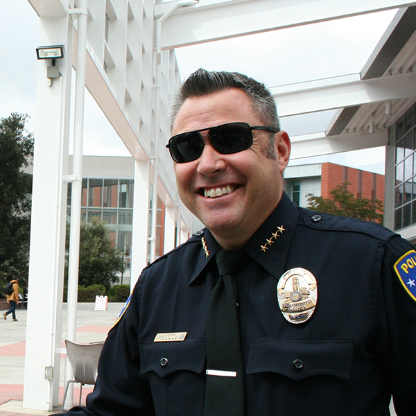 "Palomar College Police Department Chief Chris Moore with student Mike Neill during Coffee With A Cop on Sep 21. Neill stopped by the tables outside the cafeteria to, ""grab a free cup of coffee and thank the officers for all they do"". Marissa Boyd/The Telescope"