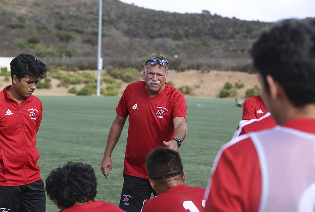 David Linenberger instructs Palomar's men's soccer team before the second match start, Sept 15. at Minkoff Field. Larie Tobias Chairul/ The Telescope