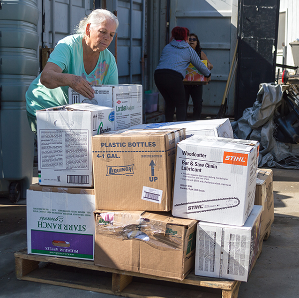Palomar ESL students, Cristina Valadez places a box on a pallet while Azucena Hernández, takes a box from Virginia Méndez, preparing to ship to Rockport, Texas for hurricane relief. Nov. 3. Raffaele Reade/The Telescope