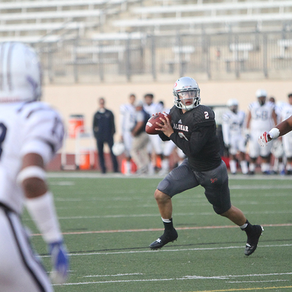 Quarterback Matt Romero looking for an opening to pass the ball during the beginning of Palomar's first homegame at Escondido High School on Sept. 16, 2017. This play put the Comets in position to score the first field goal of the game, final score Palomar 6 and Cerritos 37.