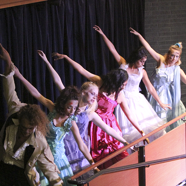 Zombie Prom Dancers strike a pose during dress rehearsal on Oct 5 in the Bruebeck Theatre. Music Danse Macabre by Saint Saens accompanied by the Palomar Pacific Coast Concert Band and Choreography by Molly Faulkner. Julie Lykins / The Telescope