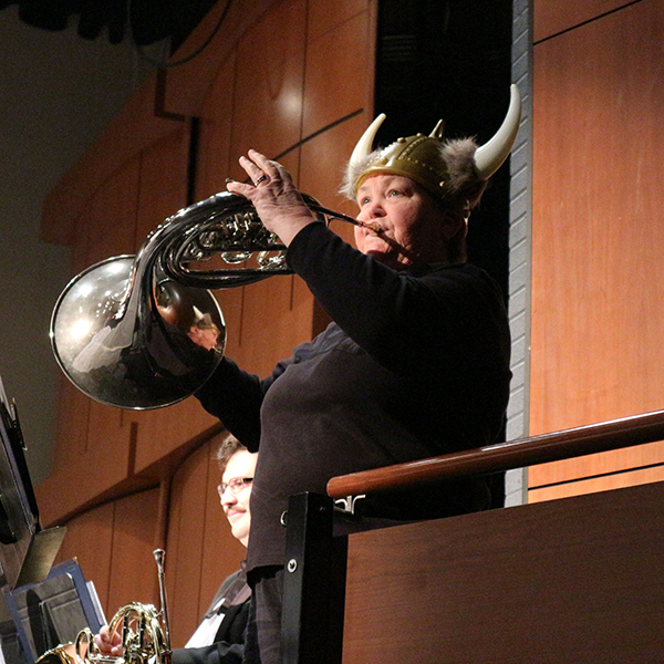 A French horn player, Cindy Monohan is playing solo for explaining the instrument at Howard Brubeck Theatre on Dec. 3. Momoko Watarai/The Telescope