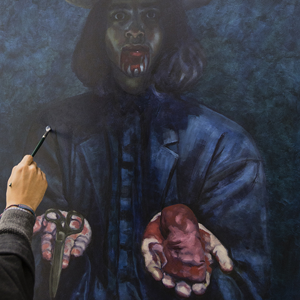 Palomar art student Matthew Perez paints a self portrait.