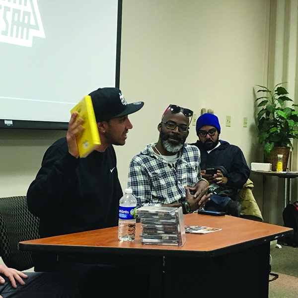 Amir Issa speaking to students about his music at San Diego State University on March 6. Pat Hartley/The Telescope