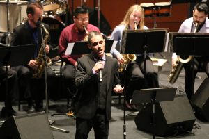 Voice, Nick Altman in the Palomar Day Jazz Ensemble. Performs in the Swingin' for the Fences band. At the Howard Brubeck Theater. He sings The way you look tonight for the audience. March.16. Ramon I Valdivia/The Telescope