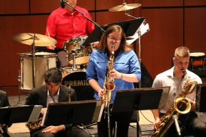 """Saxophone player Amy Walls in the band Swingin' for the Fences stands and plays for the song """"Whisper Not"""" at the Night Jazz Ensemble in the Howard Brubeck Theater the audience. March.16.Ramon I Valdivia/The Telescope"""