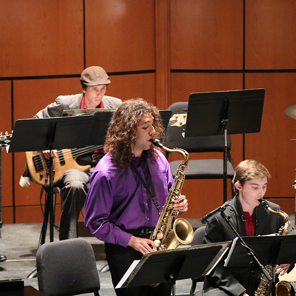 """Saxophonist Dylan Soto from the Palomar Jazz Band, Swingin' for the Fences. Stands and plays for the song """"Take the A Train"""". In the Howard Brubeck Theater for the audience. March.16. Ramon I Valdivia/The Telescope."""