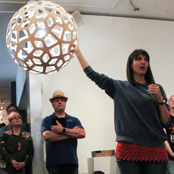 Jennifer Anderson speaks the round lamp at the Boehm Gallery on April 5. Belen De Anda /The Telescope