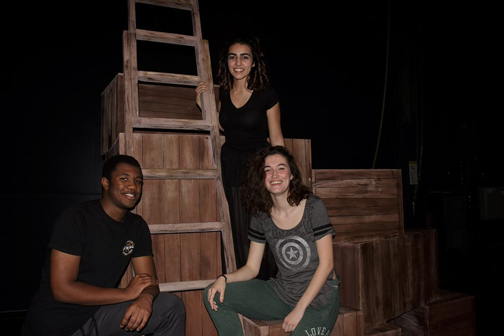 Jonathan Middleton (Peter Pan), Isabell Orahar (Molly), and Viviana McCormick (Black Stache) sit on the set of Peter and the Starcatcher after performing on a Friday night. Mar. 9, 2018. The Telescope / Jennesh Agagas