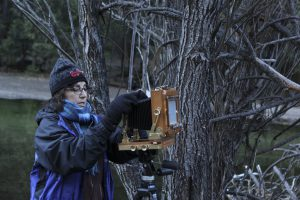 Photography Professor Donna Cosentino sets up her 4x5 wooden field camera to show students during the landscape photography class trip to Yosemite over spring break. Aubree Wiedmaier/ The Telescope