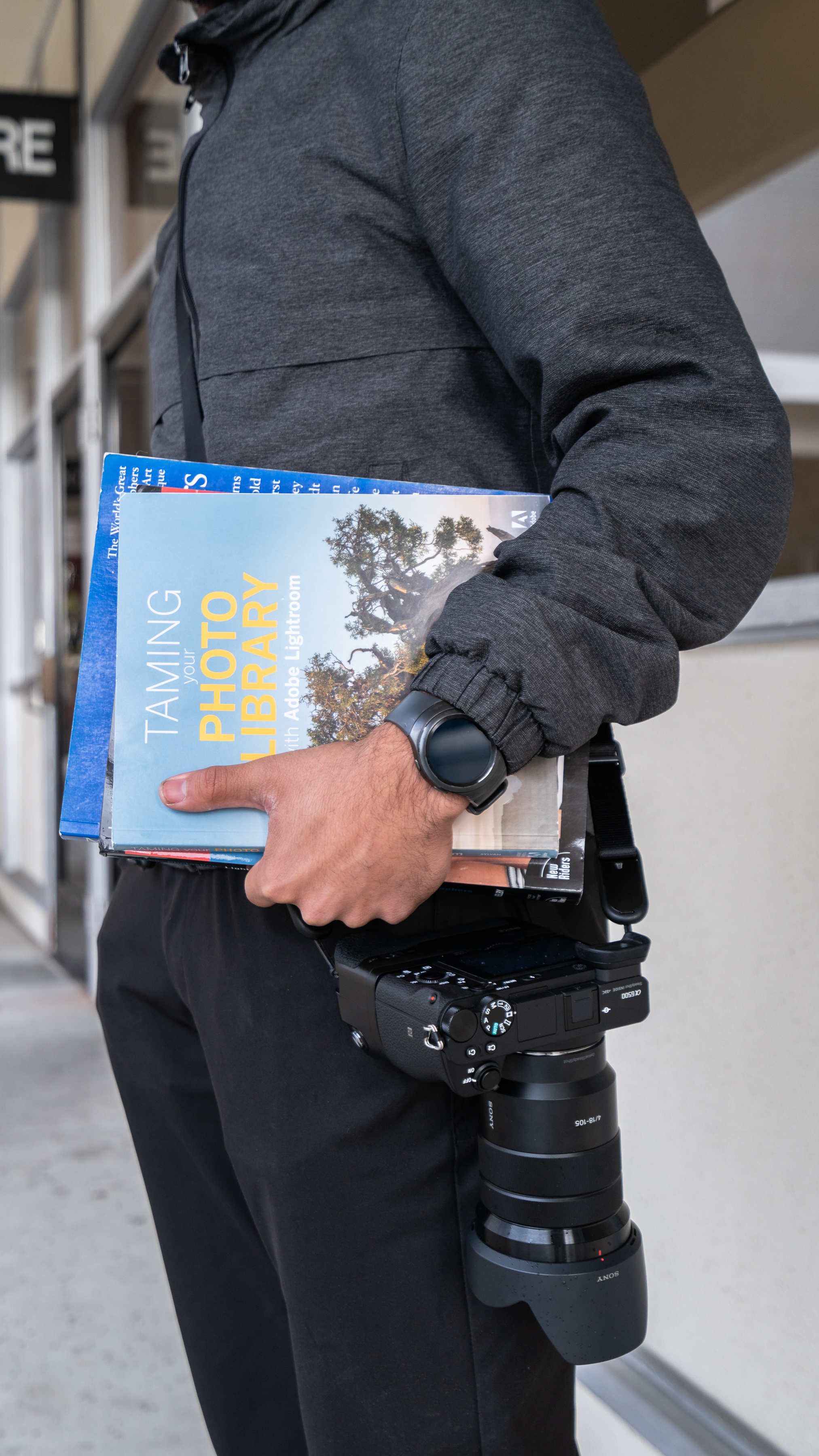 Jason Hernandez holding textbooks