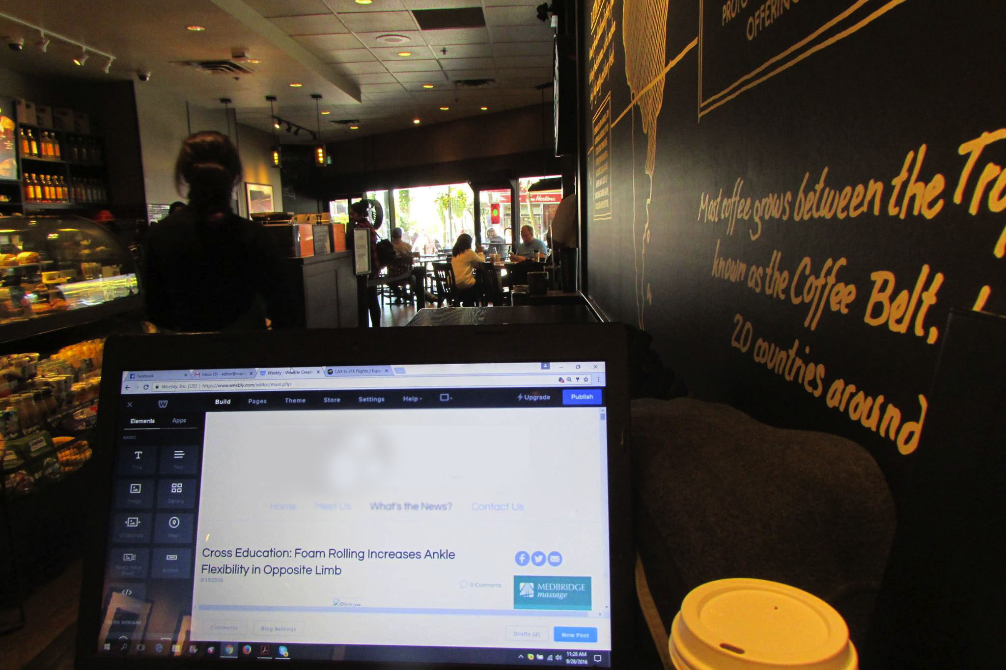 remote working at Starbucks on laptop