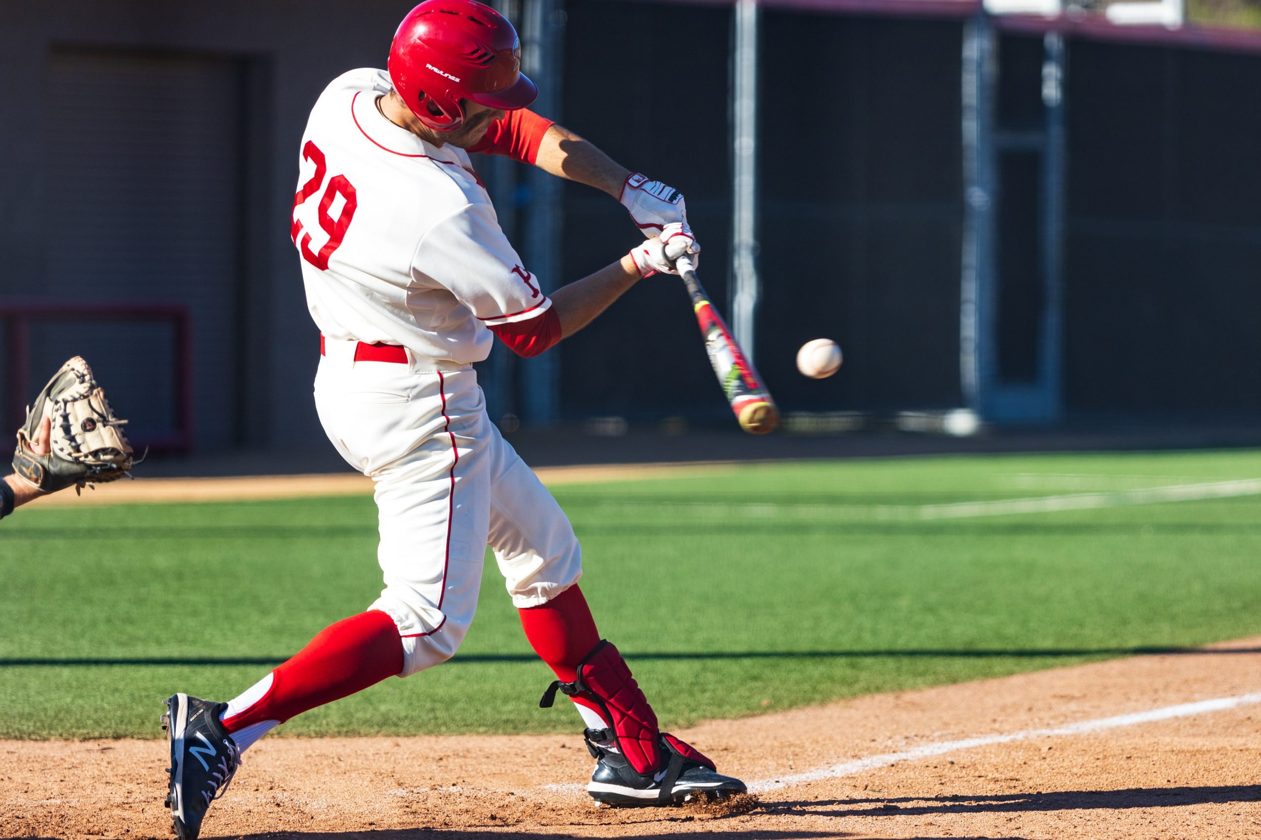 Comet outfielder Brady LaVoie swinging and hitting the ball during Palomar's 15-11 win against Fullerton College, Feb. 1, 2020. Photo by Kevin Mijares/The Telescope