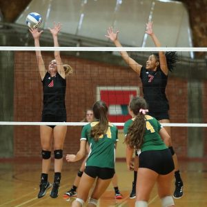 Courtney Hoffman goes up to block the volleyball in one of her matches with the Comets team. (Picture provided by Courtney Hoffman)