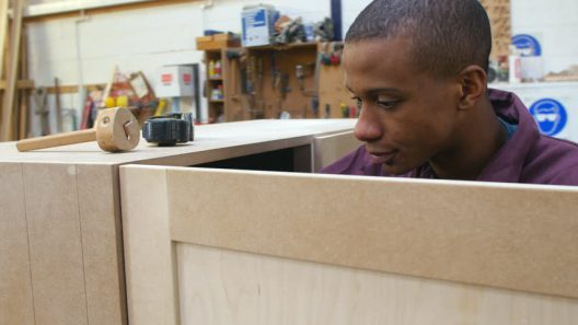 Student apprentice carpenter.